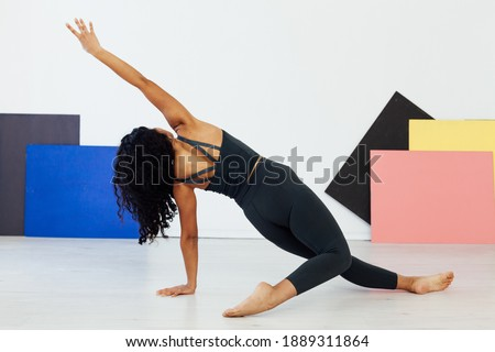 Beautiful woman engaged in yoga asana gymnastics fitness flexibility body sport