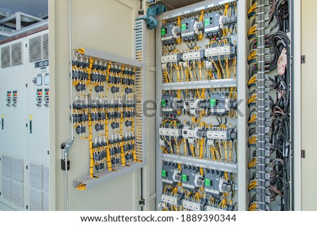 Electric control panel enclosure for power and distribution electricity. Uninterrupted, electrical voltage. Royalty-Free Stock Photo #1889390344