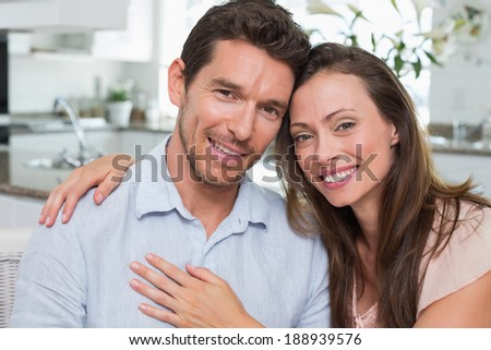 Close-up portrait of a happy young couple at home #188939576