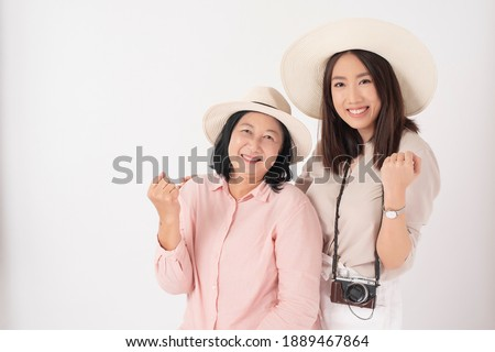 Asian older woman and her daughter on white background, Travel concept
