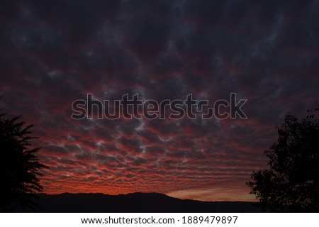 picture of dark pink blue clouds and mountain in evening. himachal pradesh india.