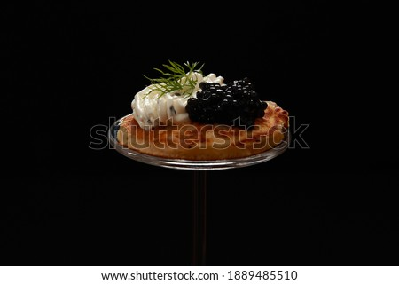 Savory Blini Pancakes with Cream Cheese and Caviar Topping a delight for a party buffet or snack. Sweet Blini could be eaten for breakfast. Originated in Russia or Ukraine is a small round version. Royalty-Free Stock Photo #1889485510