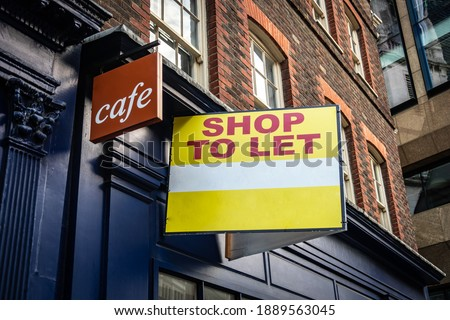 Shop to Let sign on side of vacant food retail business