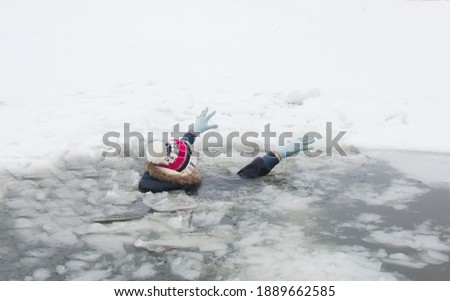 woman fell through the ice, drowning in water icy winter frosty day Royalty-Free Stock Photo #1889662585