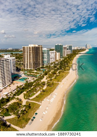 Aerial vertical panorama Miami Beach Bal Harbour FL USA beachfront real estate condominium apartments
