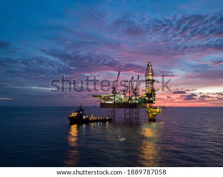 Aerial view offshore drilling rig (jack up rig) at the offshore location during sunset Royalty-Free Stock Photo #1889787058