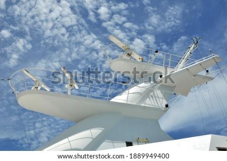 Radar antennas on a cruise ship Royalty-Free Stock Photo #1889949400