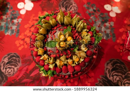 Amazing looking cake with rasperries. Perfect looking valentine's days cake. Perfect looking bakery for celebration. Lots of sugar on one picture. Birthday cake for dessert