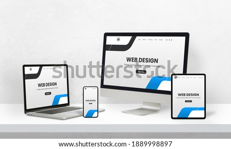 Responsive web page promotion on devices with different display sizes. Web design studio promotion concept Royalty-Free Stock Photo #1889998897
