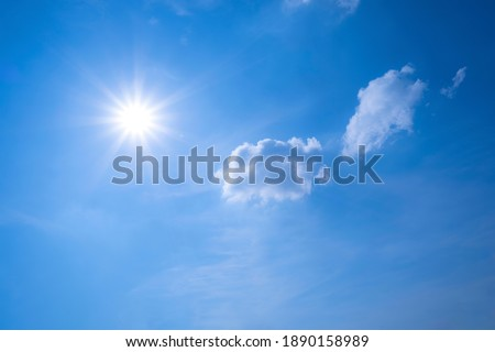 Blue sky and white clouds floated in the sky on a clear day with warm sunshine combined with cool breeze blowing against the body resulting in a miraculous refreshing like paradise Royalty-Free Stock Photo #1890158989