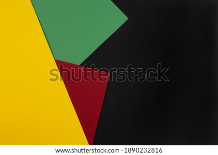 February Black History Month. Abstract Paper geometric black, red, yellow, green background. Copy space, place for your text. Top view. Royalty-Free Stock Photo #1890232816