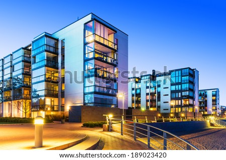 House building and city construction concept: evening outdoor urban view of modern real estate homes Royalty-Free Stock Photo #189023420