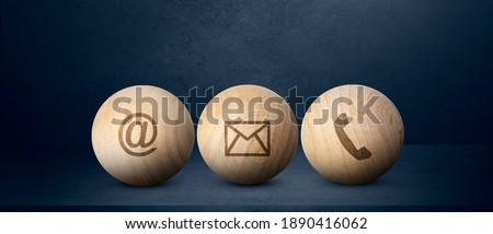 Contact us signs on wood ball spheres , symbols at, e-mail address and phone,