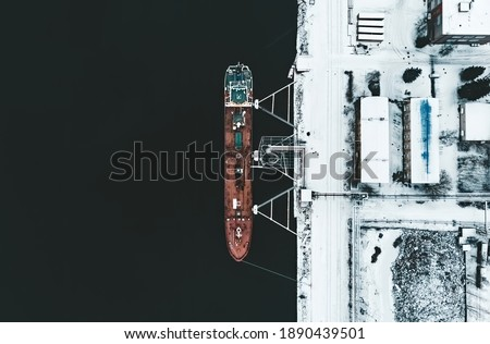 Cargo ship in the harbor at winter. Royalty-Free Stock Photo #1890439501