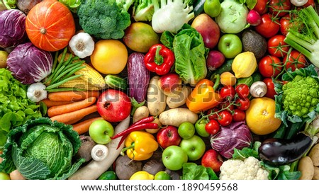 A wide variety of colorful fresh fruit and vegetables Royalty-Free Stock Photo #1890459568