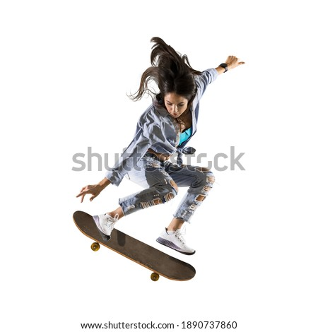 Skateboarder doing a jumping trick. Freestyle extreme sports concept isolated on white background