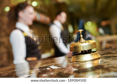 Modern luxury hotel reception counter desk with bell Royalty-Free Stock Photo #189084500