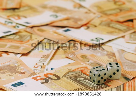 two dice with a score of 6 on a background of euro 50 banknotes #1890851428