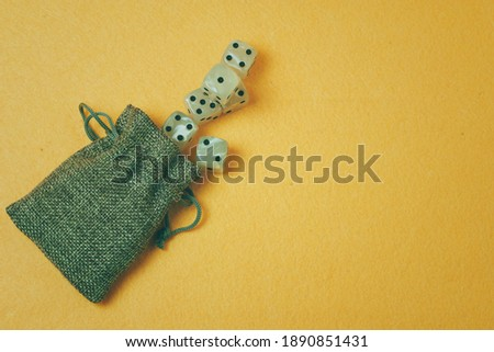 bag with white dice on a yellow background #1890851431