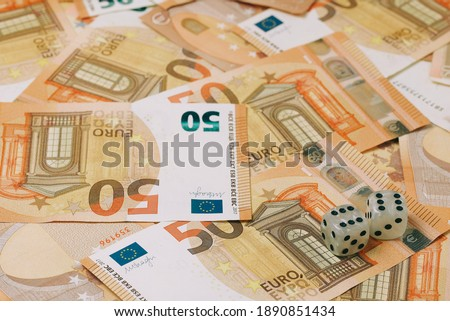 two dice with a score of 6 on a background of euro 50 banknotes #1890851434