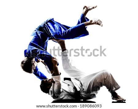 two judokas fighters fighting men in silhouettes on white background Royalty-Free Stock Photo #189086093