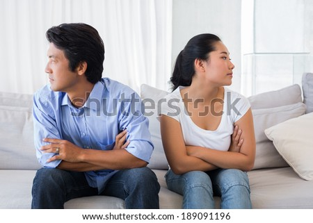 Couple not talking after a dispute on the sofa at home in the living room #189091196