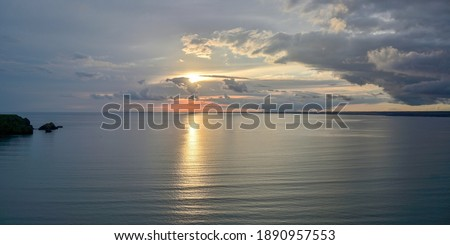 Panoramic view of quiet cove and cape stained in the sunset at Hokkaido