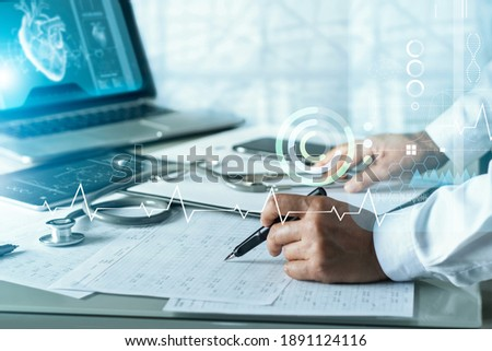 Senior cardiologist doctor analysis and diagnose checking heart disease testing result with virtual screen on laptop, Electronic medical record, Medical technology and science. Royalty-Free Stock Photo #1891124116
