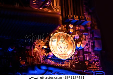 Ethereum Cryptocurrency coin on a PC computer motherboard, crypto currency mining concept. Royalty-Free Stock Photo #1891129651