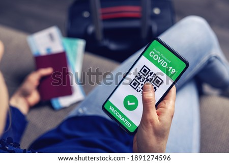 vaccinated person using digital health passport app in mobile phone for travel during covid-19 pandemic Royalty-Free Stock Photo #1891274596