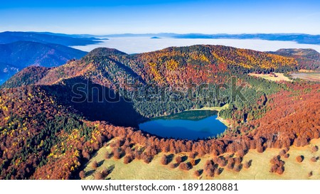 St. Ana's lake, Transylvania, Romania. Stunning autumn scenery with colorful forest and idyllic volcanic lake a popular touristic and travel destination in Europe. Royalty-Free Stock Photo #1891280881
