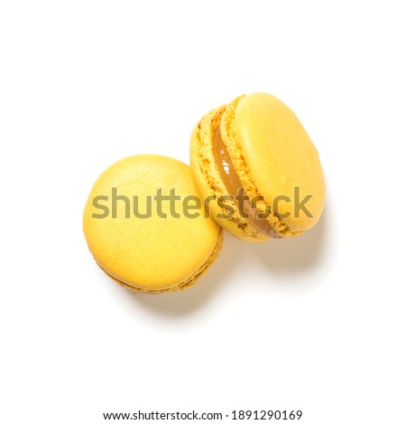 Lemon flavor macarons top view isolated on white background