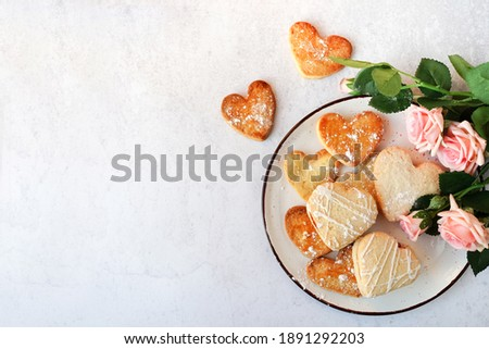 Heart shaped cookies and pink flowers roses for valentine's day , copy space