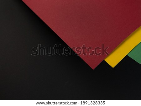 February Black History Month. Abstract Paper geometric black, red, yellow, green background. Copy space, place for your text. Top view. Royalty-Free Stock Photo #1891328335