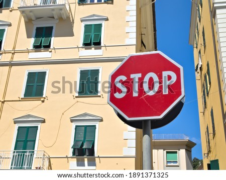 """a red road sign, """"stop"""""""