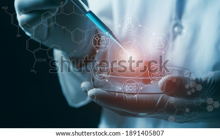 Researcher with glass laboratory chemical test tubes with liquid for analytical , medical, pharmaceutical and scientific research concept. Royalty-Free Stock Photo #1891405807