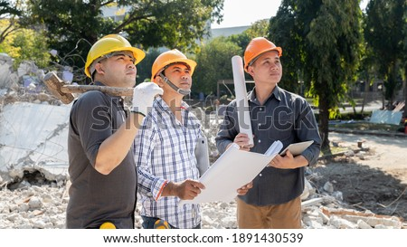 Demolition control supervisor and contractor discussing on demolish building. Royalty-Free Stock Photo #1891430539