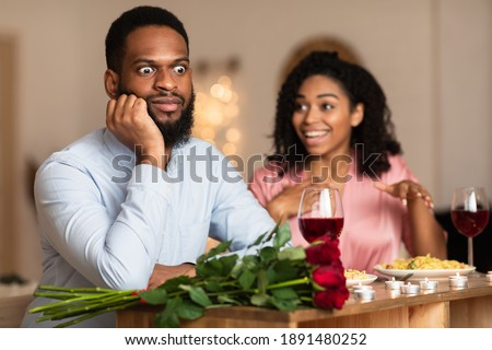 Bad Date. African American Couple Having Unsuccessful Blind Date In Restaurant, Funny Disappointed Shoked Black Man Feeling Embarrassment Listening To Excited Woman Talking Royalty-Free Stock Photo #1891480252
