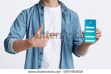 Man Pointing At Smartphone With Flight Booking App On Screen, Unrecognizable Guy Recommending Air Tickets Reservation Services Website, Standing Over White Background, Creative Collage