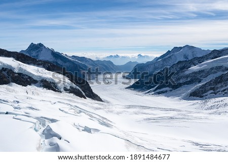 Amazing view of Aletsch Glacier, the largest glacier in the Alps, world heritage of Swiss and Bernese alps alpine snow mountains peaks, beautiful landscapes view downhill from the top of Jungfraujoch. Royalty-Free Stock Photo #1891484677