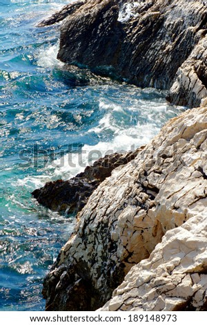 Sea and rock reef. Royalty-Free Stock Photo #189148973