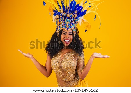 Brazilian afro woman posing in samba costume over yellow background with free space