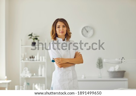 Beautician in the cosmetology office. Cosmetologist doctor dermatologist in a beauty clinic. Facial skin treatment. Beauty treatments. Royalty-Free Stock Photo #1891499650