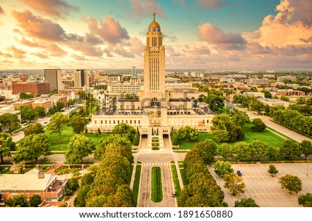 Lincoln skyline and Nebraska State Capitol. The Nebraska State Capitol is the seat of government for the U.S. state of Nebraska and is located in downtown Lincoln. Royalty-Free Stock Photo #1891650880