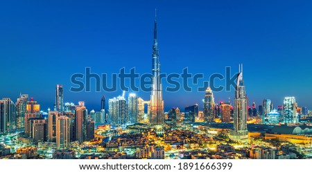 Dubai - city center skyline and bussy evening after sunset with colorful sky, United Arab Emirates Royalty-Free Stock Photo #1891666399