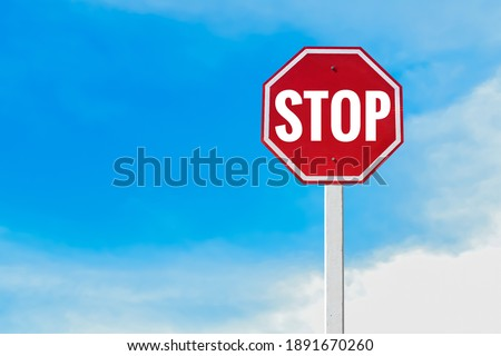 Traffic sign; Isolated 'STOP' sign on pole with clipping paths.