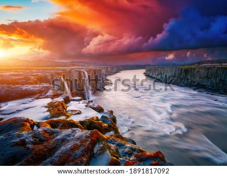 Mighty stream of breathtaking Selfoss cascade. Location place Vatnajokull National Park, Iceland, Europe. Vibrant photo wallpaper. Image of most popular world landmarks. Discover the world of beauty. Royalty-Free Stock Photo #1891817092