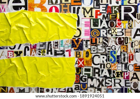 Torn and crumpled pieces of yellow paper on collage from clippings with newspaper magazine letters and numbers. Ripped yellow paper glued on alphabet letters cutting from magazine background. Royalty-Free Stock Photo #1891924051