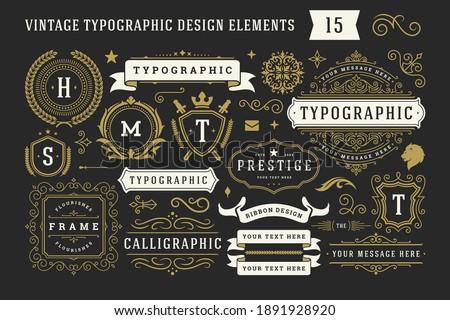 Vintage typographic decorative ornament design elements set vector illustration. Labels and badges, retro ribbons, luxury fancy logo symbols, elegant calligraphic swirls, flourishes ornate vignettes.