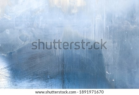 Distressed overlay. Weathered glass. Blue layer with white smeared stains dust scratches defect. Faded window surface with noise effect for photo editor. Royalty-Free Stock Photo #1891971670